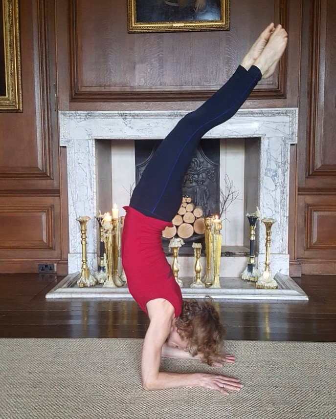 Victoria Woodall wearing Asquith practicing a handstand.