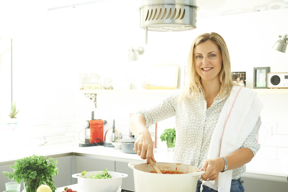 Lizzie King from Lizzie Loves Healthy in the kitchen