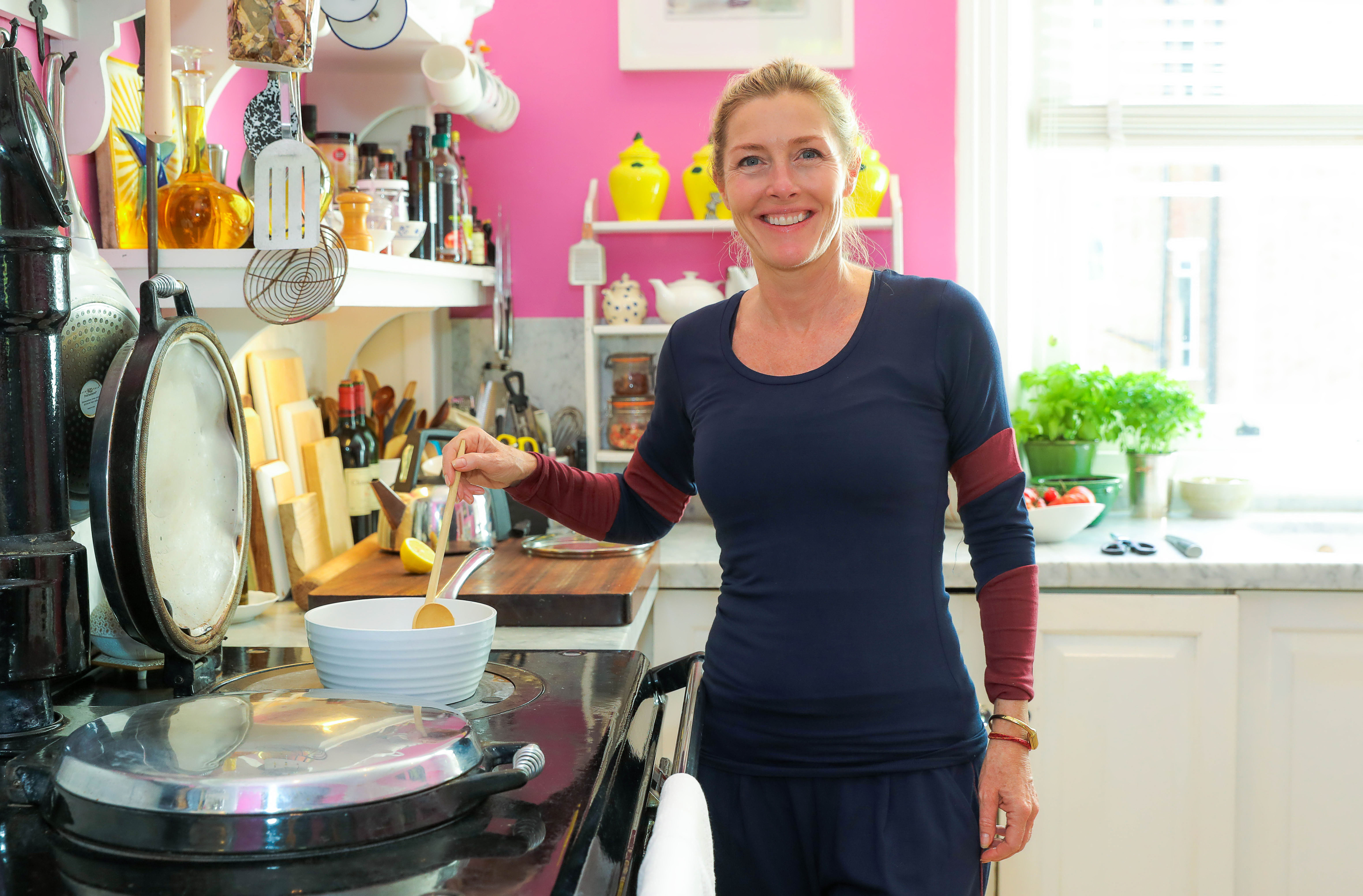 Sophie Conran wears Asquith organic activewear in her pink kitchen.