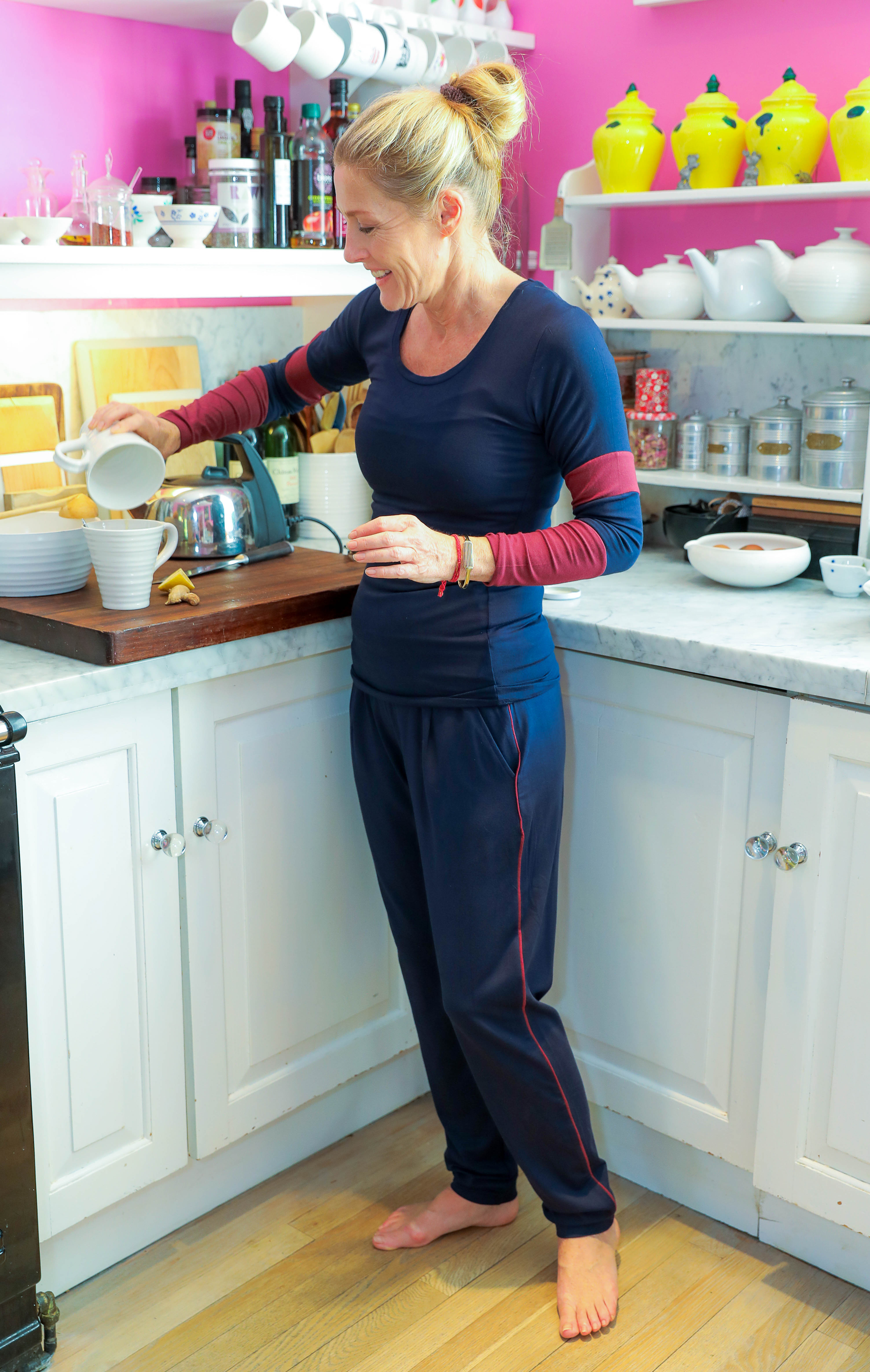 Sophie Conran wears Asquith eco-friendly activewear in her pink kitchen.