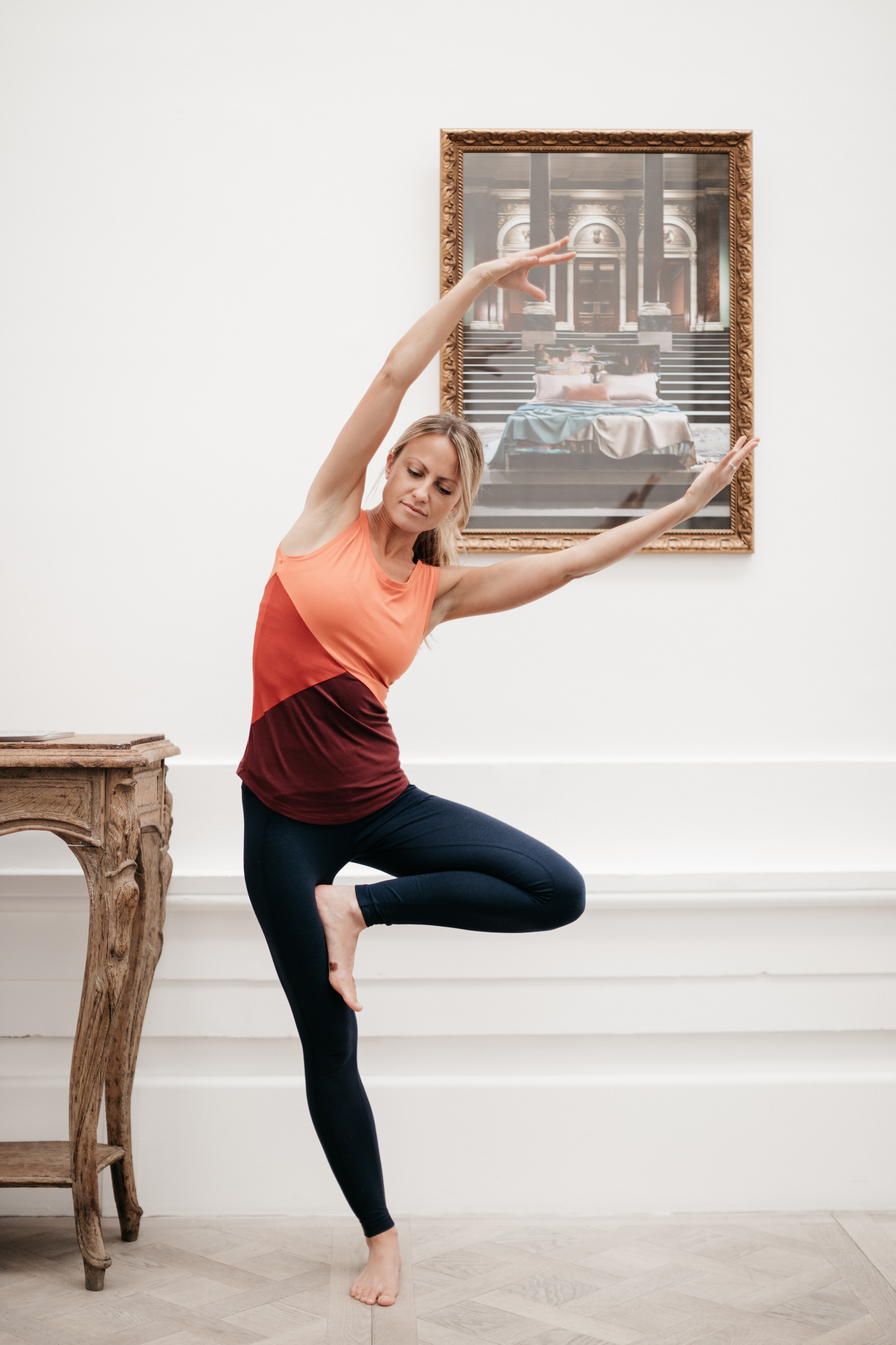 Yoga Teacher holding Tree Pose wearing Asquith bamboo yoga top and bamboo yoga pants.